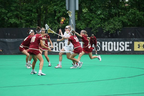 Girls playing Lacrosse match